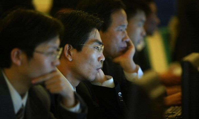 The Chinese Communist Party tightly controls China's Internet using five main approaches. (Frederic J. Brown/AFP/Getty Images)