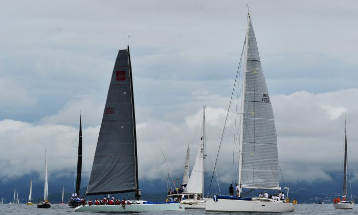 Boats cruising around the Committee Boat waiting for the start of Race-2 of the Hebe Haven Quest Yachting Typhoon Series on Sunday June 22, 2014. After waiting for more than 2-hours, lack of wind forced the proceedings to be abandoned. (Bill Cox/Epoch Times)