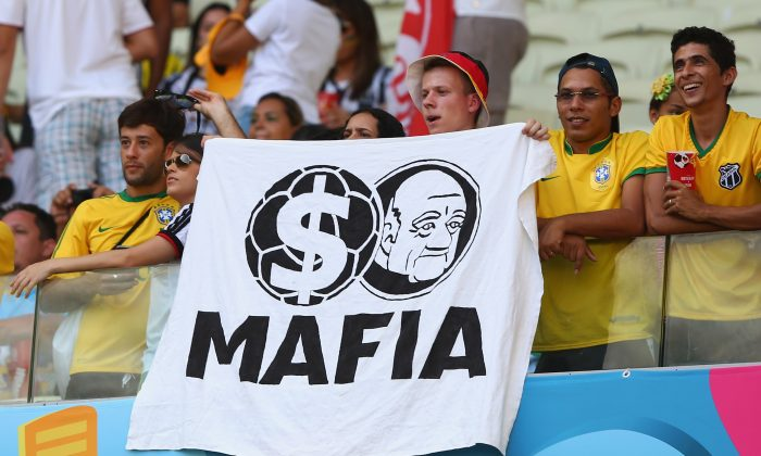A fan holds up a protest banner during the 2014 FIFA World Cup Brazil match between Germany and Ghana in Fortaleza, Brazil, on June 21, 2014. (Martin Rose/Getty Images)