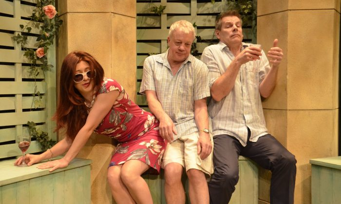 (L–R) Lottie, disguised as Chloë (Sarah Stanley), is thwarted by her husband's friend Reggie (Kim Wall) from seducing her husband, Teddy (Bill Champion), who thinks she's a possible new love interest in a screwy new comedy. (Andrew Higgins)