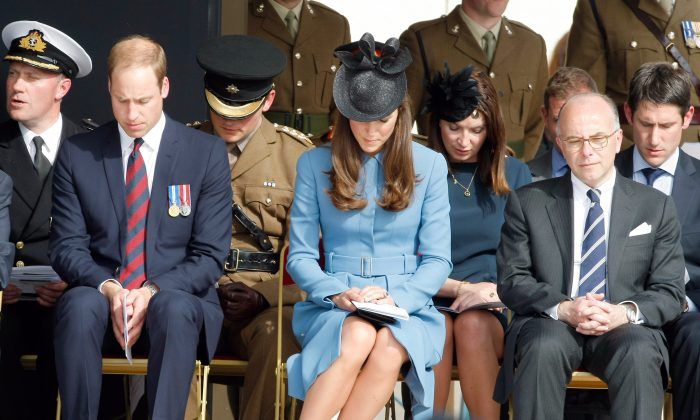 Prince William, Duke of Cambridge, and Kate the Duchess of Cambridge and French Interior Minister Bernard Cazeneuve, right, attend a remembrance ceremony, in Arromanches, France, Friday, June 6, 2014, as part of commemorations of the 70 anniversery of the D-Day landing. World leaders and veterans gathered by the beaches of Normandy on Friday to mark the 70th anniversary of World War Two's D-Day landings. (AP Photo/Claude Paris, Pool)