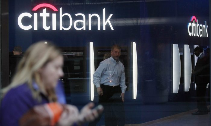 People walk past a Citibank branch on in New York City. (Mario Tama/Getty Images)