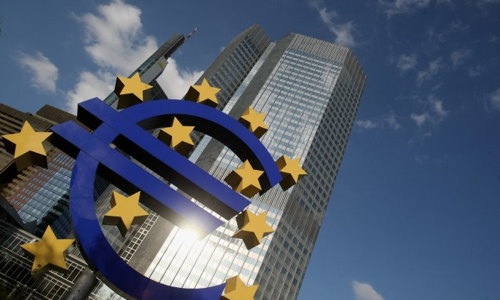 The euro logo stands in front of the headquarters of the European Central Bank (ECB) in Frankfurt, Germany, April 9, 2009. (Ralph Orlowski/Getty Images)