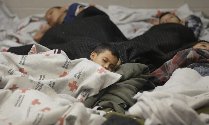 Detainees sleep in a holding cell at a U.S. Customs and Border Protection processing facility, on in Brownsville, Texas on June 18. (Eric Gay/Getty Images)