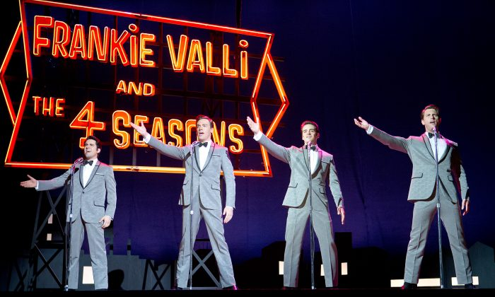 """John Lloyd Young as Frankie Valli, Erich Bergen as Bob Gaudio, Vincent Piazza as Tommy DeVito, and  Michael Lomenda as Nick Massi in the movie-musical """"Jersey Boys."""" (Warner Bros.)"""