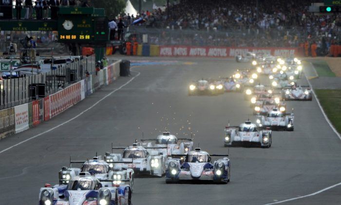 Drivers take the start at the 82nd 24 Hours of Le Mans endurance race in Le Mans, western France, on June 14, 2014. 54 cars with162 drivers are participating in the race on June 14 and 15. ( Jean-Francois Monier/AFP/Getty Images)