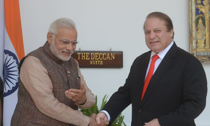 India's newly sworn-in Prime Minister Narendra Modi (L) gestures to Pakistani Prime Minister Nawaz Sharif as they shake hands during a meeting in New Delhi on May 27, 2014. Improving relations with Pakistan could offer Modi the possibility of transforming the region, argues Alyssa Ayres. (Raveendran/AFP/Getty Images)