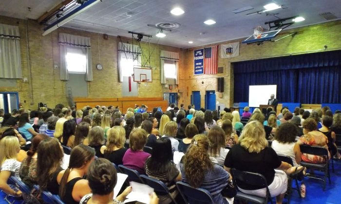 "Over 100 educators from the North Arlington Public Schools in New Jersey assemble for a professional development session conducted by Vincent J. Bove prior to the school year on Sept. 3, 2013. All attendees received copies of ""Early Warning Timely Response: A Guide to Safe Schools."" (Vincent J. Bove)"