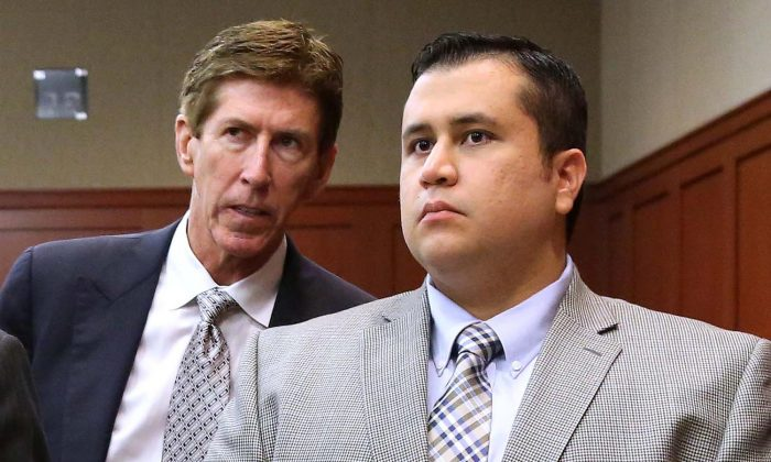 Defense attorney Mark O'Mara, left, talks to defendant George Zimmerman during a recess in Zimmerman's trial in Seminole circuit court in Sanford, Fla. June 17, 2013. (AP Photo/Orlando Sentinel, Joe Burbank, Pool, File)