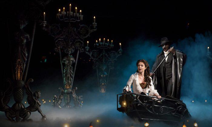 Christine (Sierra Boggess) is spirited away by the Phantom (Norm Lewis) to his underground world. (Matthew Murphy)