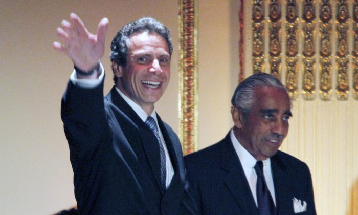 Andrew Cuomo, then New York attorney general, joins Charles Rangel in a birthday fundraiser for the congressman on Aug. 11, 2010. (AP Photo/Mary Altaffer)