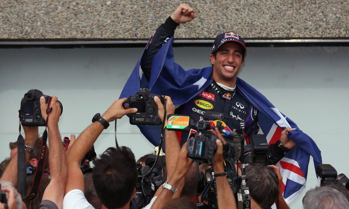 Race winner Daniel Ricciardo of Red Bull Racing is carried aloft by his pit crew following his first grand prix victory at the Formula One Canadian Grand Prix at Circuit Gilles Villeneuve on June 8, 2014 in Montreal, Canada. (Tom Pennington/Getty Images)
