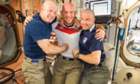 U.S. Astronauts Shave Heads After World Cup Loss (Video)