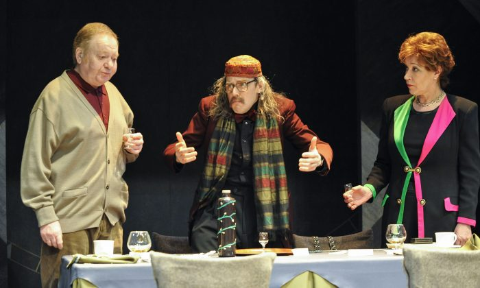 Patriarch Gerry (Russell Dixon) (L) celebrates the birthday of his wife (Sarah Parks) with some help by a waiter (Ben Porter) (C). Ayckbourn's play is part of the Brits Off Broadway series. (Andrew Higgens)