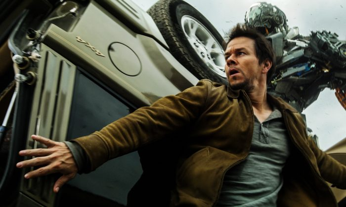"""Cade Yeager (Mark Wahlberg) is chased by Autobot Lockdown in """"Transformers: Age of Extinction."""" (Paramount Pictures)"""