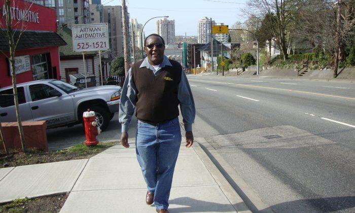 Lawrence Chidzambwa strolls down a street in his new Burnaby neighbourhood. (Courtesy Lawrence Chidzambwa)