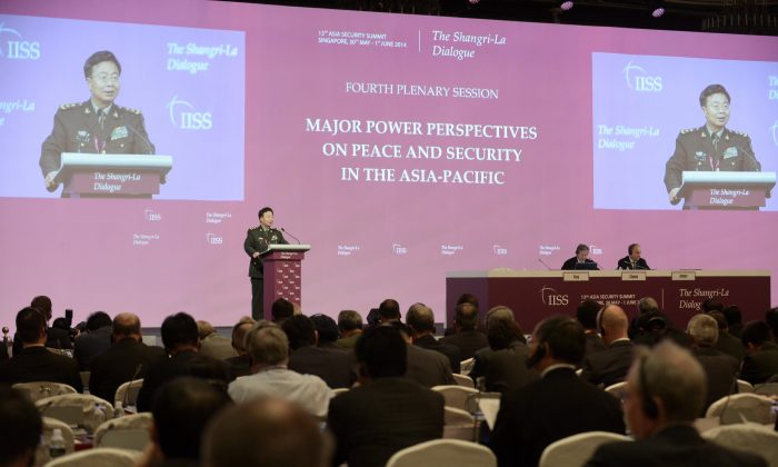 Deputy Chief of the General Staff of the People's Liberation Army (PLA) Wang Guanzhong speaks during the fourth plenary session at the 13th International Institute for Strategic Studies (IISS) Shangri-La Dialogue (SLD) in Singapore on June 1, 2014. Wang's remarks are part of a larger Chinese strategy of establishing territorial sovereignty in the South China Sea with the help of propaganda techniques, experts say. (Roslan Rahman/AFP/Getty Images)