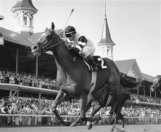 In this May 6, 1978 file photo, Affirmed, with jockey Steve Cauthen up, crosses the finish line to win the 104th running of the Kentucky Derby in Louisville, Ky. (AP Photo/File)