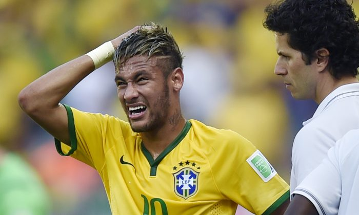 Brazil's Neymar reacts during the World Cup round of 16 soccer match between Brazil and Chile at the Mineirao Stadium in Belo Horizonte, Brazil, Saturday, June 28, 2014. (AP Photo/Martin Meissner)