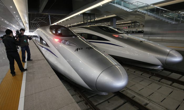 Bullet trains of a new high-speed railway linking Shanghai with Hangzhou Tuesday, Oct. 26, 2010 in Shanghai, China. (AP Photo/Eugene Hoshiko)