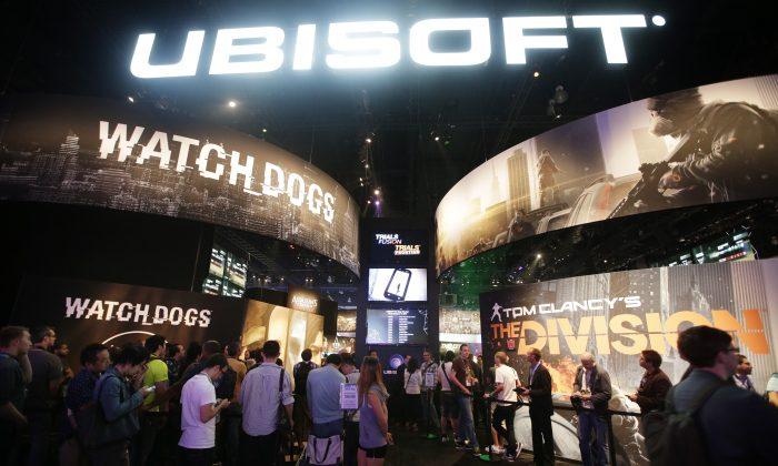 """FILE - This June 12, 2013 file photo shows attendees waiting in line for  presentations on the video games, """"Watch Dogs"""" and """"Tom Clancy's The Division"""" at the Ubisoft booth during the Electronic Entertainment Expo in Los Angeles. The recent success of """"Watch Dogs"""" and """"Titanfall"""" is paving the way for several new video games that don't contain numbers in their titles to be hyped at next week's Electronic Entertainment Expo, the gaming industry's annual trade show held on June 10-12, 2014, in Los Angeles. With anticipation mounting for original games like """"Destiny,"""" """"The Order: 1886"""" and """"Sunset Overdrive,"""" have game makers finally discovered the cure for sequelitis? (AP Photo/Jae C. Hong, file)"""
