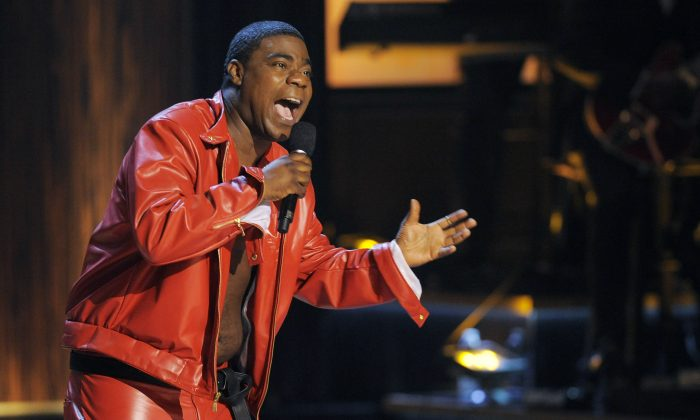 """FILE - In this Nov. 3, 2012 file photo, comedian Tracy Morgan performs at """"Eddie Murphy: One Night Only,"""" a celebration of Murphy's career at the Saban Theater in Beverly Hills, Calif. Morgan is recovering but is expected to remain hospitalized for several weeks after having surgery on a broken leg suffered in a chain-reaction crash on the New Jersey Turnpike early Saturday, June 7, 2014, that left two others critically injured and one dead. (Photo by Chris Pizzello/Invision, File)"""
