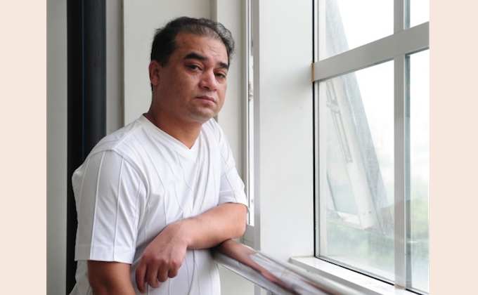 """Ilham Tohti, economics professor and webmaster of a popular Uyghur website, was arrested in late 2013 for advocating """"splittism"""". Draconian restrictions on internet usage restrain Uyghur users in Xinjiang Province to a virtual cage, says a human rights group. (Frederic J.Brown/AFP/Getty Images)"""
