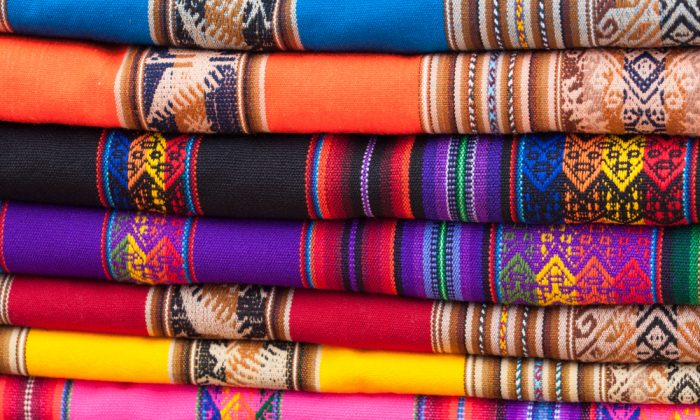 Stack of colorful fabric rags on market display in Peru, South America. (*Shutterstock)