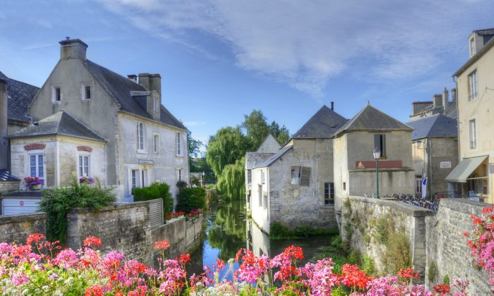 Evening on the river embankment of town Bayeux. Normandy. (*Shutterstock)