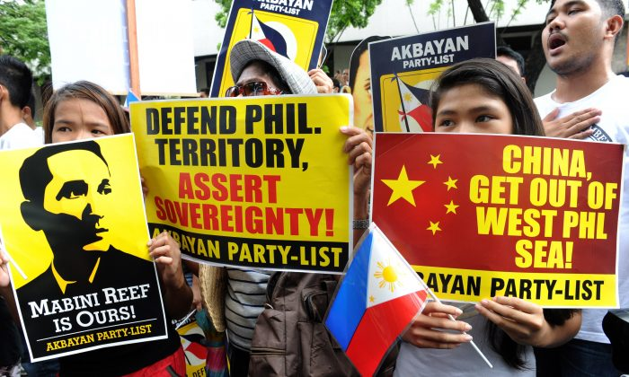 Filipino protesters display placards during a rally against China's claim to areas of the South China Sea, at the Chinese consulate in Manila on June 12, 2014. (Jay Directo/AFP/Getty Images)