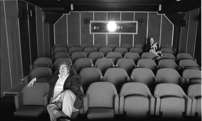 Gene Siskel and Roger Ebert in screening room for photo shoot for People Weekly, June 13, 1984; Chicago. (Kevin Horan/Magnolia Pictures)