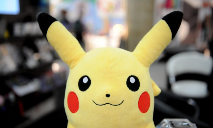 "An article saying scientists are questioning the ""existence of Pokemon"" after a ""live Pikachu"" was caught in Africa is fake.  (STAN HONDA/AFP/Getty Images)"