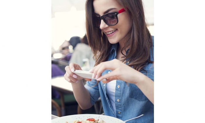 One of the many things foodies are derided for is taking photos of their meal. The trend is so common that some restaurants have actually banned it, saying it annoys other customers. (gpointstudio/iStock/Thinkstock)