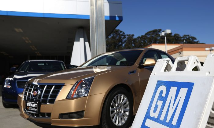 New cars sit on the sales lot of a Chevrolet dealership. The appalling, expanding, GM and Chrysler ignition switch recalls started with poor craftsmanship. (Justin Sullivan/Getty Images)