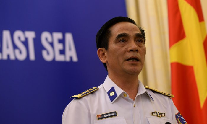 Ngoc Ngoc Thu, deputy commander of the Vietnam Coast Guard, addresses tensions between China and Vietnam during a press conference in Hanoi on June 5. On Wednesday China announced it was removing its controversial oil rig from waters between Vietnam and the Paracel Islands. (HOANG DINH NAM/AFP/Getty Images)