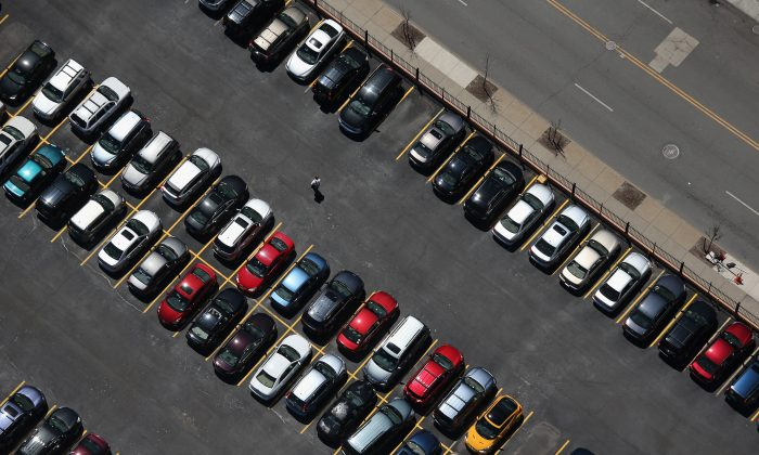 A man walks through a parking lot on June 4, 2013 in Buffalo, New York, near the U.S.-Canada border. The aerial view was seen from a helicopter flown by the U.S. Office of Air and Marine (OAM), which monitors and patrols the U.S.-Canada border. (John Moore/Getty Images)