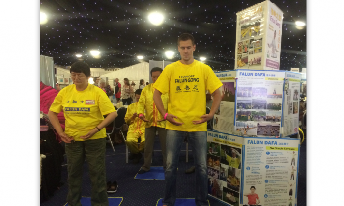 Falun Gong practitioners demonstrated the Exercises at their stand in the Health and Healing Festival in Leeds, UK, on July 12th and 13th. (Epoch Times)