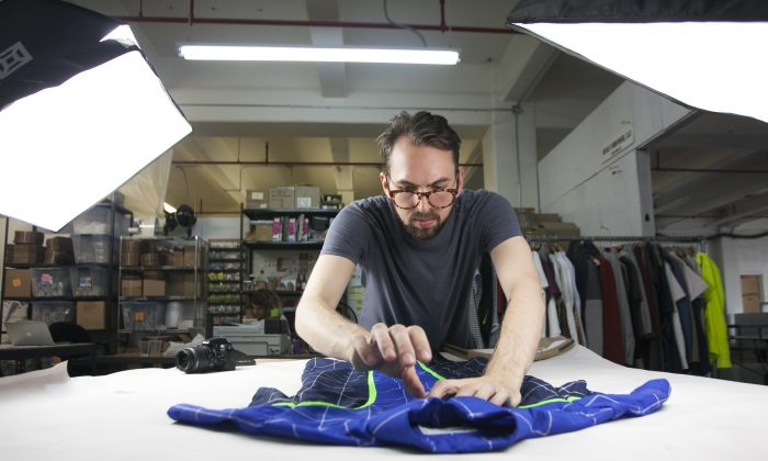 David Krause setting up a photo shoot for Alder New York at Pratt Institute's Brooklyn Fashion+Design Accelerator's temporary space at the Brooklyn Navy Yard, July 14, 2014. (Samira Bouaou/Epoch Times)