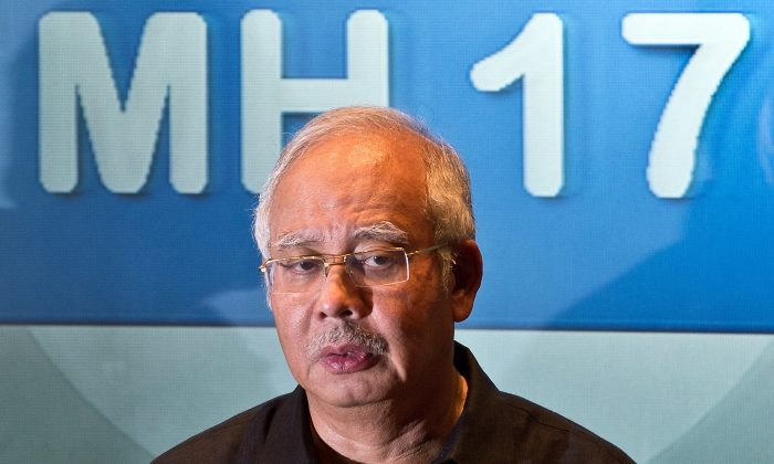 Malaysia's Prime Minister Najib Razak addresses a press conference at a hotel in Sepang, ouside Kuala Lumpur, on July 18, 2014, after Malaysia Airlines flight MH17 carrying 298 people from Amsterdam to Kuala Lumpur crashed in eastern Ukraine. A Malaysian airliner carrying 298 people from Amsterdam to Kuala Lumpur crashed on July 17 in rebel-held east Ukraine, as Kiev said the jet was shot down in a 'terrorist' attack. Ukraine's government and pro-Russian insurgents traded blame for the disaster, with comments attributed to a rebel commander suggesting his men may have downed Malaysia Airlines flight MH17 by mistake, believing it was a Ukrainian army transport plane. (MANAN VATSYAYANA/AFP/Getty Images)