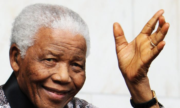 Nelson Mandela leaves the InterContinental Hotel after a photoshoot with celebrity photographer Terry O'Neil on June 26, 2008 in London, England. Mandela is in London in advance of the 46664 concert being held at Hyde Park on Friday the 27th June to celebrate Nelson Mandela's 90th Birthday. (Chris Jackson/Getty Images)