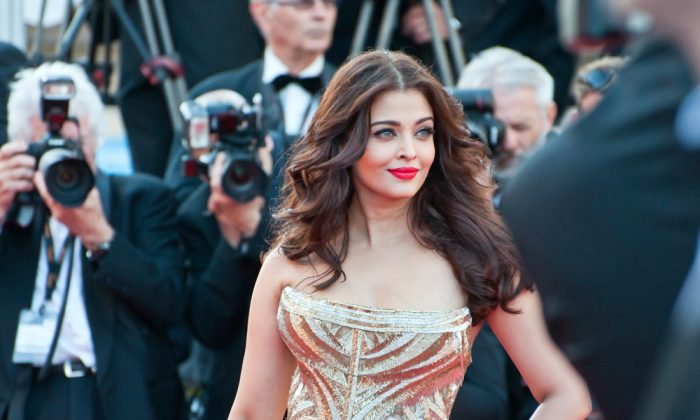 Actress Aishwarya Rai walks down the red carpet during the 67th Annual Cannes Film Festival. (*Shutterstock)