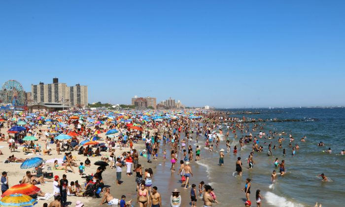 People relax and recreate on a hot Summer day, Coney Island, New York City, on July 6, 2014. (Brendon Fallon/Epoch Times)