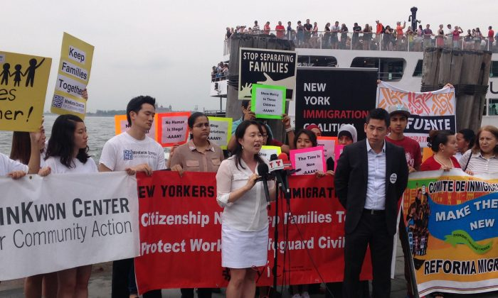 Grace Shim, executive director of the MinKwon Center for Community Action (L) and Steven Choi, executive director of the New York Immigration Coalition (R), at an immigration reform press conference in Lower Manhattan, New York, Monday, July 14, 2014. (Yi Yang/Epoch Times)