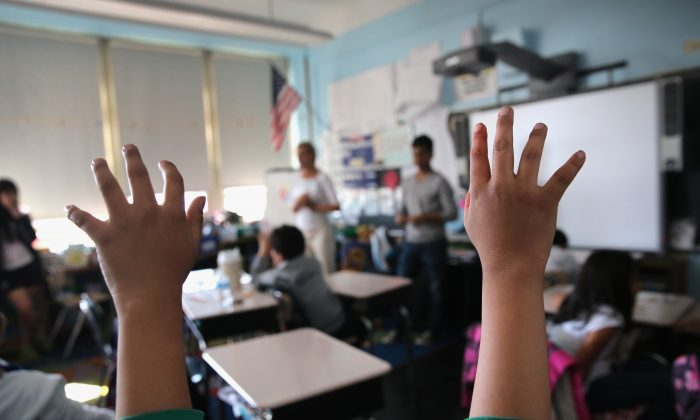 Tibetan immigrant children ask questions during an after-school program for asylum immigrants run by the International Rescue Committee (IRC), on April 25, 2013 in the Queens borough of New York City. (John Moore/Getty Images)