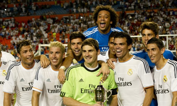 Real Madrid holds their trophy after winning the 2013 International Champions Cup match between Real Madrid and Chelsea on August 7, 2013 at Sun Life stadium in Miami Gardens, Florida. (DON EMMERT/AFP/Getty Images)