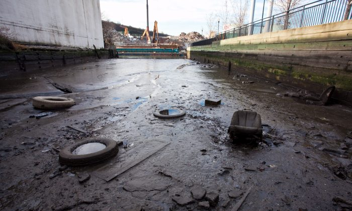 Trash and sludge are visible in the heavily polluted Gowanus Canal on Jan. 24, 2012. (Epoch Times)