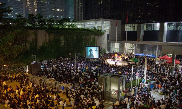 """Thousands jam Civic Square in Hong Kong protesting the denial of a broadcast license to Hong Kong Television Network on Oct. 21, 2013 in Hong Kong. A government press release announcing the fencing off of this square referred to """"recent public order events,"""" which is believed to be a reference to protests like this one. (Lam Yik Fei/Getty Images)"""