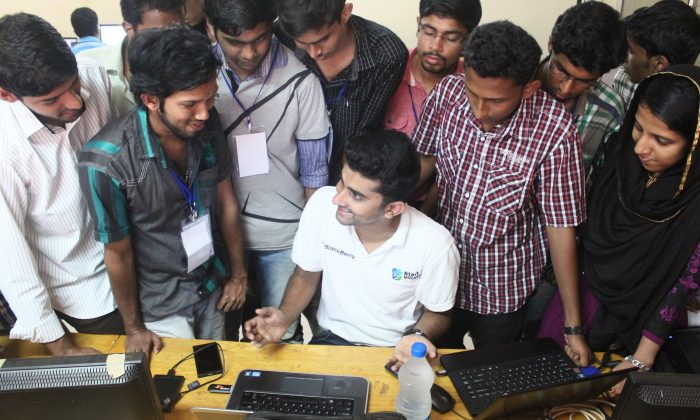 Youngsters interact with a mentor in in one of India's first Startup Villages in Kochi, Kerala State, India, on Feb., 16, 2013. On July 10, the Indian government announced more funding for entrepreneurship in the country. (Courtesy of Startup Village)