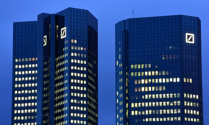The Deutsche Bank AG headquarters stands illuminated in the twilight on January 09, 2014 in Frankfurt am Main, Germany. (Thomas Lohnes/Getty Images)