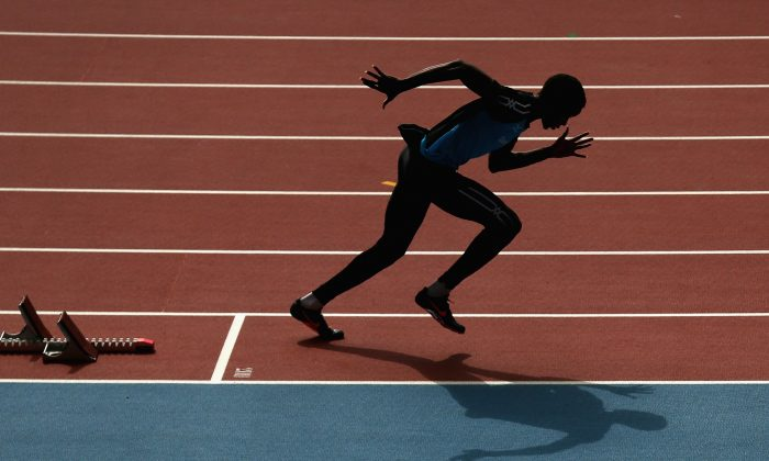 An athlete trains at Hampden Park, venue for the track and field athletics ahead of the Commonwealth Games on July 23, 2014 in Glasgow, Scotland. (Photo by Cameron Spencer/Getty Images)